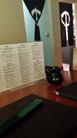 En sushi & robata grill: restaurant interior wiht menu