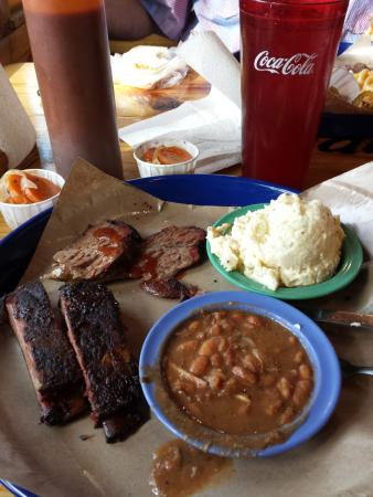 Brisket and ribs with beans and potato salad.