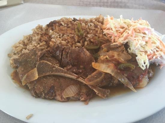 Pork chop with rice, beans, and coleslaw - Picture of Aquatic