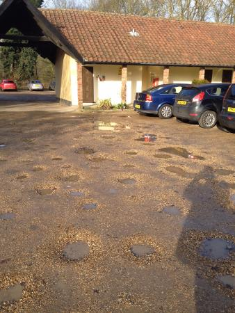Brome, UK: Potholed carpark.