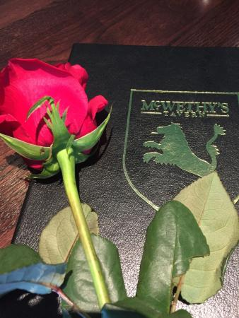 McWethy's Tavern: Valentine's Day received a long stem rose from the restaurant ❤️