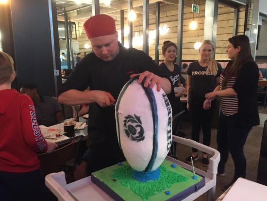 Byron Aberdeen: Chef cutting the cake
