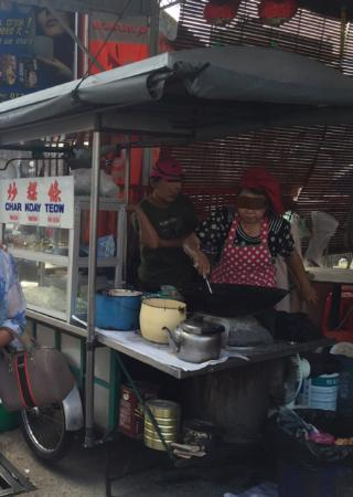 Dirty cooking area with charcoal everywhere - she used same hand to handle food and charcoal