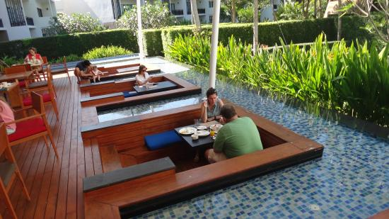 Sunken tables in water for dining Изображение holiday