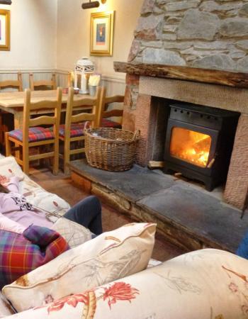 lovely fire in winter tartan cushions picture of coach house rh tripadvisor co nz