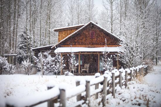The Ranch at Rock Creek: A private luxury cabin in the winter; one of four types of lodging available at The Ranch.
