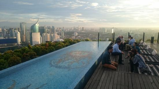 View over pool of city skyline picture of skye bar restaurant jakarta tripadvisor for Indoor swimming pool in jakarta