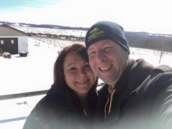 Luthersburg, PA: My wife and I posing in front of the grapes on a snowy winter day.
