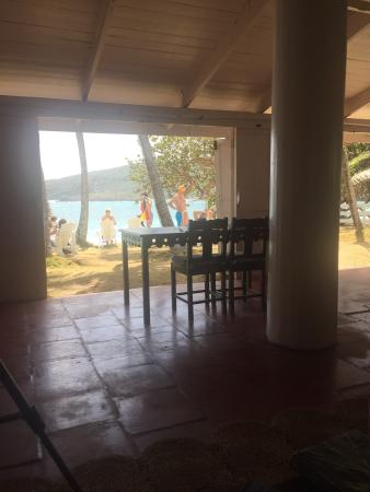 Sugar Reef Bequia: Sugar Reef Cafe. Chilled bottle of Carib beer. And what a view to the Atlantic beach!