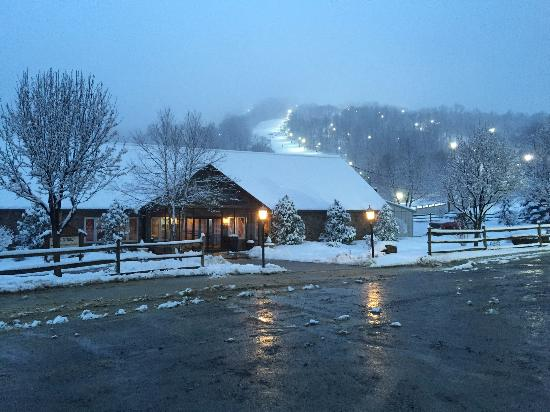 Roundtop Mountain Resort: The lodge at dusk with one of the ski trails in the background.
