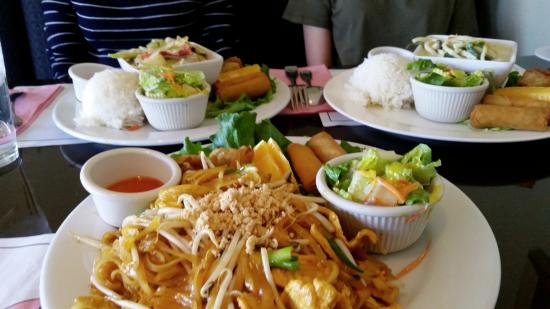 Spices Thai Cafe: Pad thai chicken (front); green curry chicken (behind left); red curry chicken (behind right)