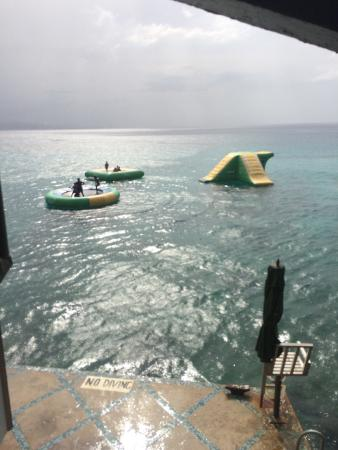 Jimmy Buffett's Margaritaville: Jump off the cliff and swim over to the trampoline & slide