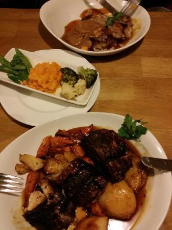 "Station Inn Oxenholme: Cremated Belly Pork, overcooked veg, ""leg"" of lamb"