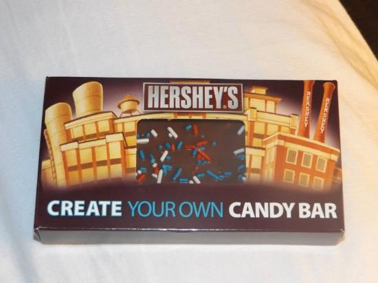 Selecting your candy bar inclusions from the Create Your Own Candy Bar creation kiosk. The first choice you make is which type of chocolate bar you want as a base. Your choices for the base chocolate bare include milk chocolate, dark chocolate and white chocolate.