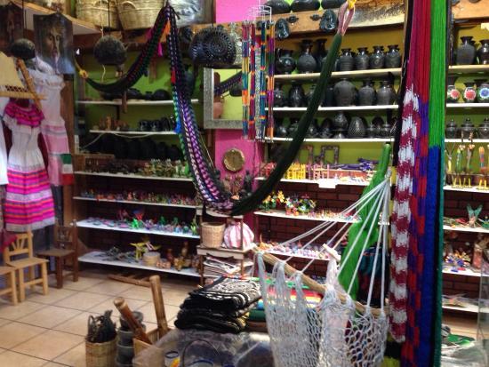 City Market: Juan sells Alibrijes (beautiful Oaxaca wood carvings), barro negro (Oaxaca black clay pottery) a