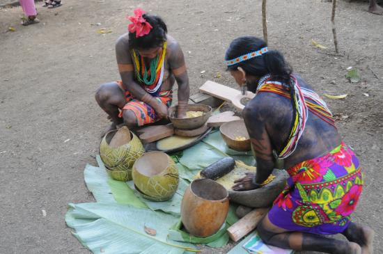 Yaviza, Panama: Ladies of the Embera tribe preparing maize