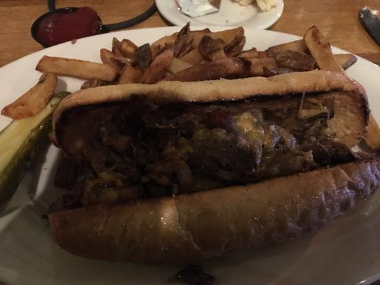 The Elbow Room: Stuffed sliced steak on a soft roll with homemade fries