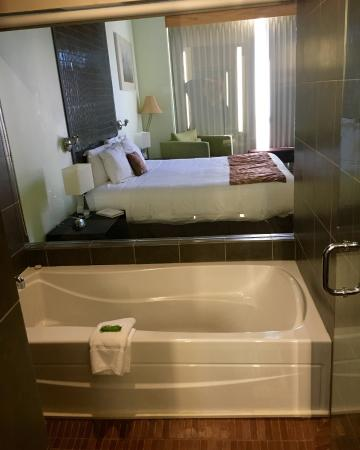 Japanese tub room bed and tiled head board picture of for Weird bathrooms