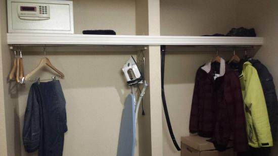 Monte Carlo Inn Oakville Suites: Hallway storage space & wall-attached combination safe