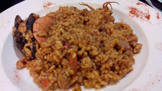 Paella de pescado fotograf a de canela restaurant - Paella de pescado ...
