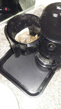 Quality Inn Gainesville: Old crap in desk, used tea bags in coffee maker, gross stains in recliner, and the worst stains