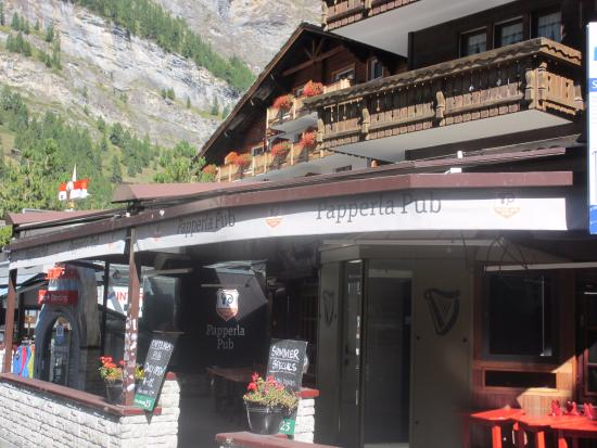 Papperla Pub direct on the road in the winteryou can ski down from the slopes
