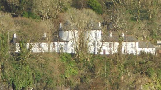 سنترال جيست هاوس: on the opposite side of the valley, you have Dr William Price's Roundhouses