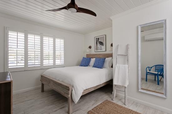 Inn on the Beach: Your serene bedroom awaits