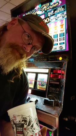 Casino at Fitzgeralds Hotel : My Husband Playing the Dollar Coins