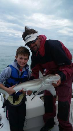 Tarpon Time Fishing Charters: Black tip reef shark - my son's first shark ever!