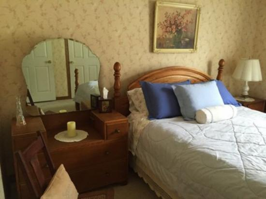 Harrison, ID: This is a peacefully elegant room. The Dove is decorated in soft colors, while warm light wood f