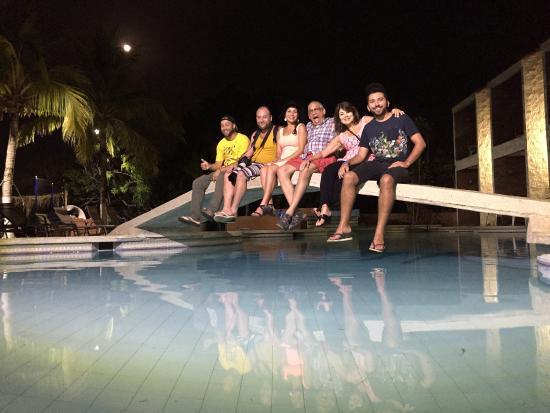 El Sabanero Beach Hotel: Full family and a full moon after a delicious meal at El Sabanero Restaurant