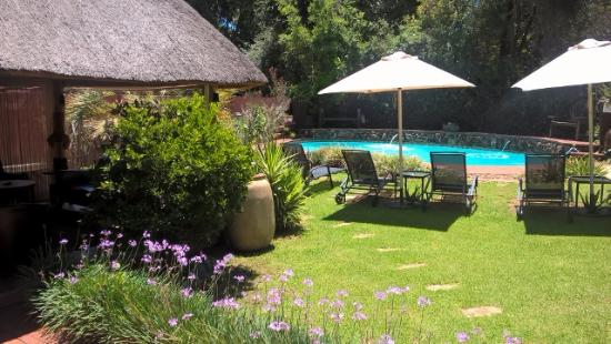 Sitatunga Guest Lodge & Transfers: View from the dining to the pool