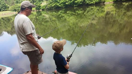 Father and son fishing picture of fish pond cabins for Father son fishing