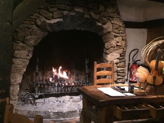 inglenook fire in the restaurant with reception desk in front rh tripadvisor com sg