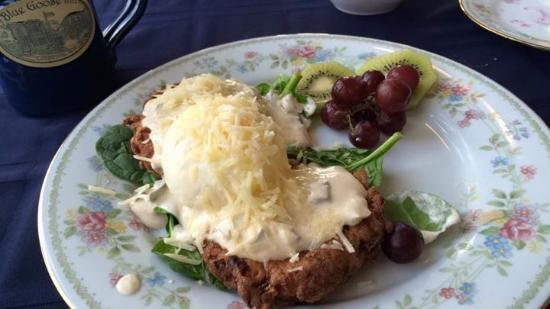Blue Goose Inn Bed and Breakfast: Breakfast Day 3: Sweet potato pancakes topped w/ poached egg and creamy poblano sauce in a bed o
