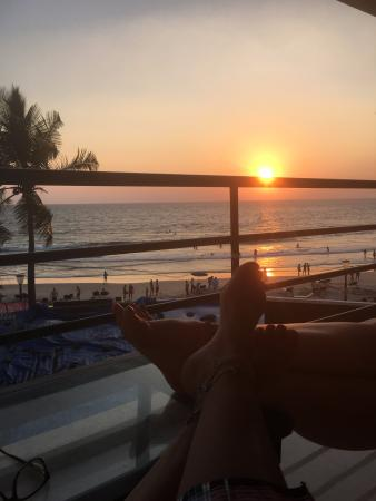 The Ocean Park Beach Resort: Sunset and you can see the roof top of shops in front of hotel. Note not blocking any view