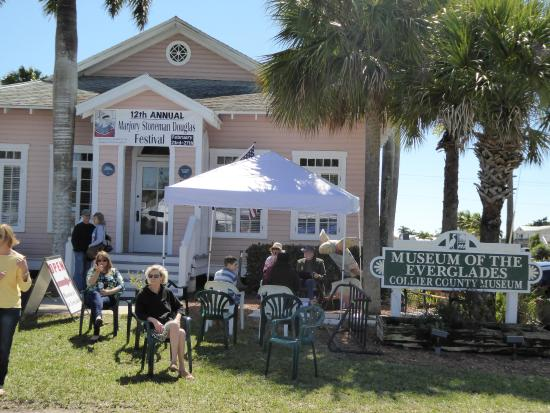 Marjory Stoneman Douglas Festival participants relax in front of the Museum of the Everglades