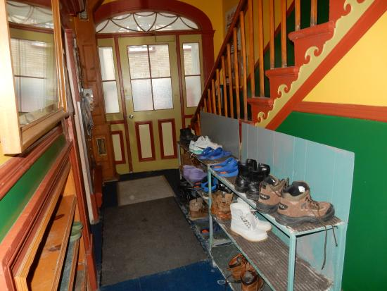Auberge de la Paix: Hallway near office. Tenants had to leave boots on shelves there so they keep hostel cleaning.