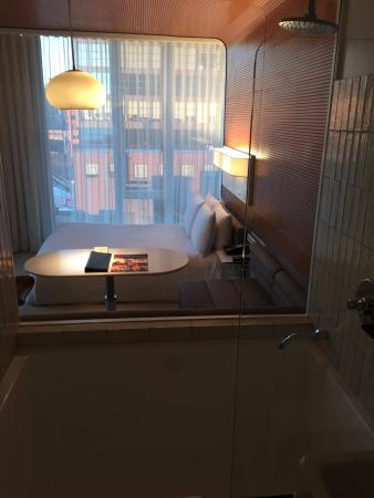 view of room through glass wall separating bathroom from bedroom rh tripadvisor ie