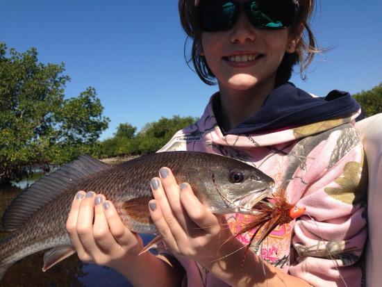 Boca Grande, Φλόριντα: Young lady catching red fish