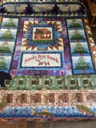 Smoky Bear Ranch : Beautiful quilts, hand made by the owner, adorn every bed.