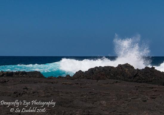 Honaunau, HI: Beautiful waves crash onto the surrounding rocky shoreline.