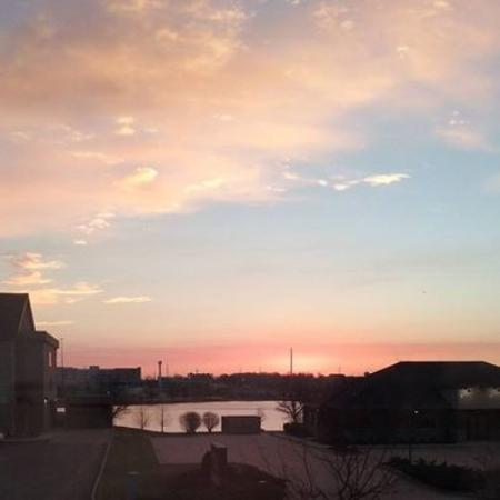 Extended Stay America - Evansville - East: View of the sunrise in the morning over looking the lake across the street.