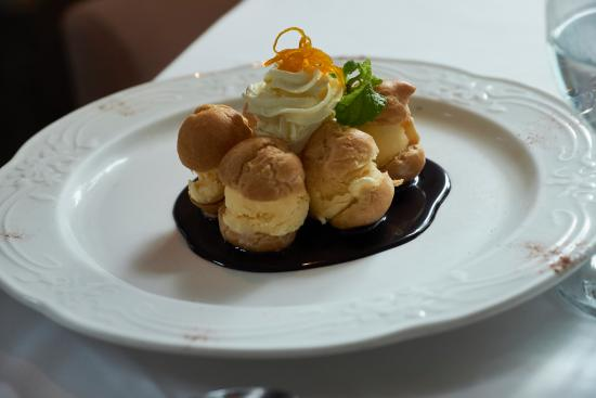 Chef Jessie Restaurants : Classic profiteroles on a bed of rich dark chocolate.