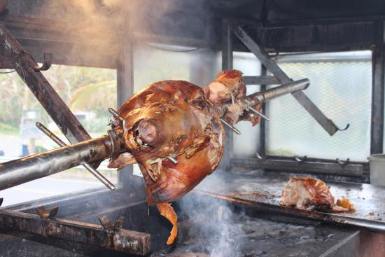 pig roasting over open fire picture of lechonera los pinos cayey