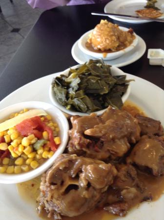Oxtails With Cornbread Dressing Collard Green And Succotash