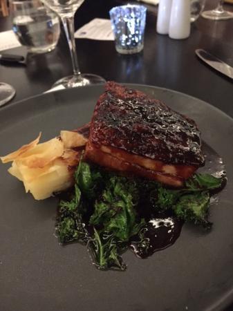 Medowie, Australia: Mple glazed twice cooked pork belly, potato gallette, wilted kale and apple crisps