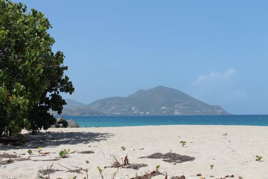 Nevis: view of St Kitts from lover's beach....coral sand