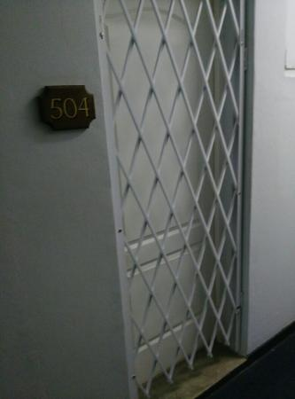 Parkview Hotel: A hotel room with a steel gate in front of the door... a bit scary.